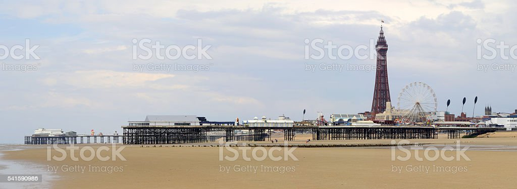 Panoramic View of Blackpool Tower, Beach and Piers stock photo