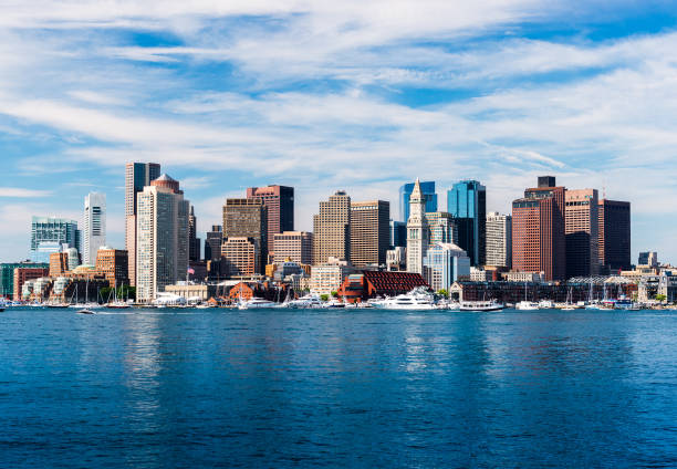 Panoramic view of Boston skyline, view from harbor, skyscrapers in downtown Boston, cityscape of the Massachusetts capital, USA stock photo