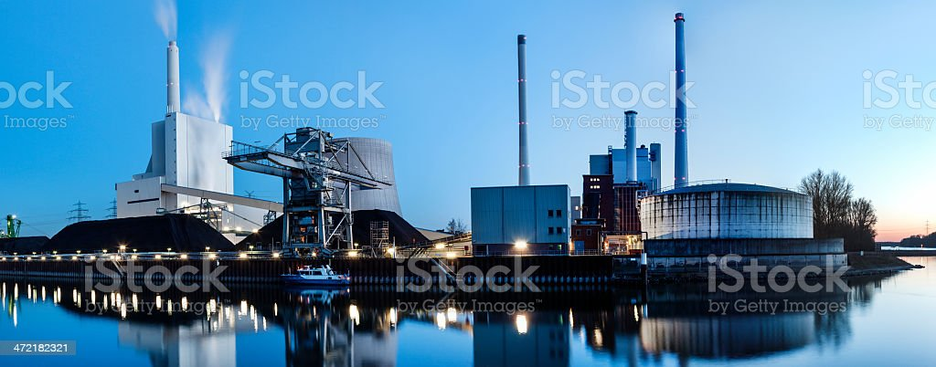 Panoramic view of coal-fired power plant at dusk stock photo