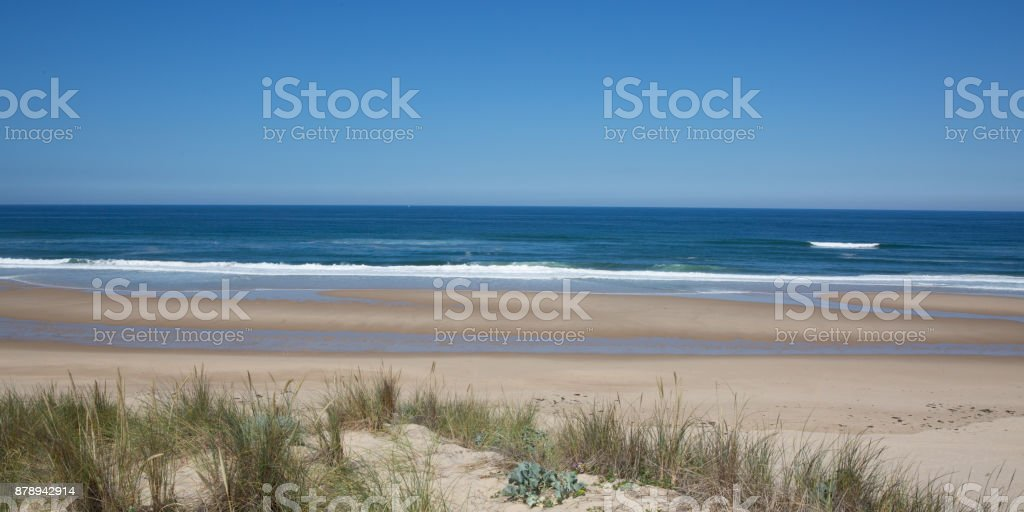 Panoramic view of coastline and beach with blue sky, stock photo