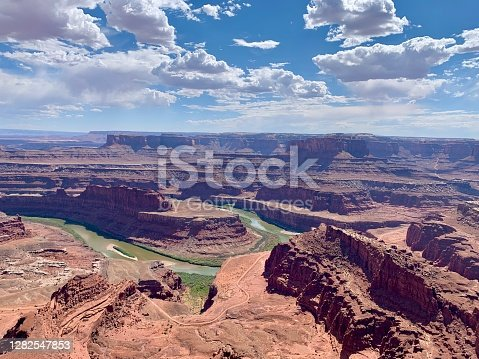 Panoramic view of Colorado river canyon from Dead Horse Point in Utah. La sal Mountains are visible on the horizon.