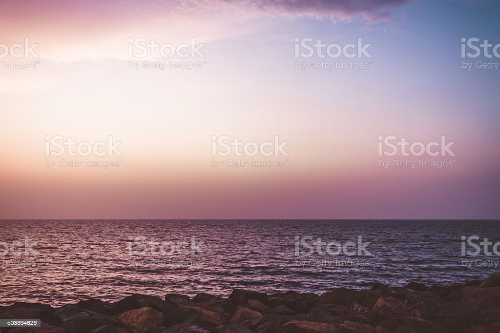 Panoramic view of colorful sky over Arabian Sea stock photo