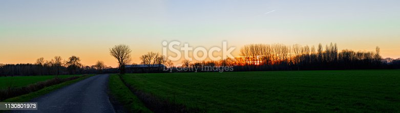 istock Panoramic view of countryside landscape during the sunset 1130801973