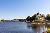Uglich, Russia - August 11, 2018 : Panoramic view of cruise ships in Uglich pier on a sunny summer day. The Transfiguration Cathedral of the Kremlin in Uglich, Russia. Golden Ring of Russia . Preobrazhensky sobor.