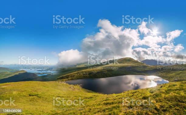 Photo of Panoramic view of Devils Punch Bowl lake on Mount Mangerton in the morning