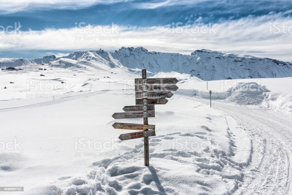 Panoramic view of Dolomiti in Seiser Alm with trail signs stock photo