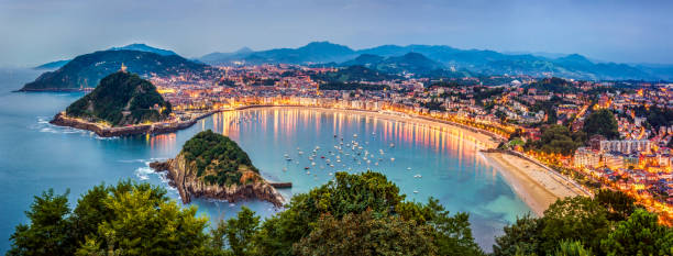 Panoramic view of Donisti san sebastian at sunset. Euskadi, Spain View of Donosti San Sebastian at Dusk from Monte Igueldo. Basque Country. Spain spain stock pictures, royalty-free photos & images