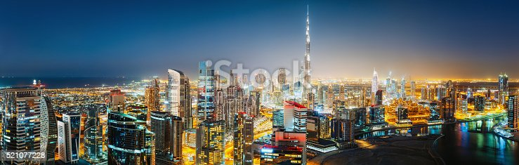 istock Panoramic view of Dubai by night. Travel background. 521077228