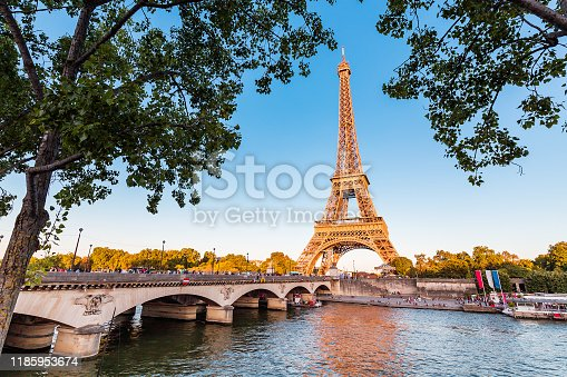 Panoramic view of Eiffel tower and Seine river at golden sunset. Travel landmarks in Europe and France
