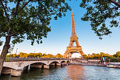 istock Panoramic view of Eiffel tower and Seine river at golden sunset. Travel landmarks in Europe and France 1185953674