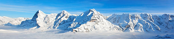 Panoramic view of Eiger, Monch & Jungfrau massif, Swiss Alps Panoramic view of Eiger, Monch & Jungfrau massif, Swiss Alps, Switzerland, Europe swiss alps stock pictures, royalty-free photos & images