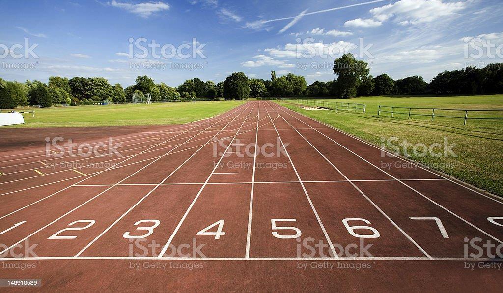 Panoramic view of empty running track stock photo
