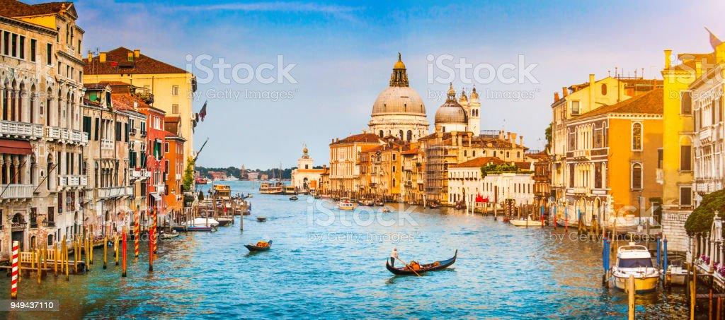 Panoramic view of famous Canal Grande and Basilica di Santa Maria della Salute at sunset in Venice, Italy stock photo