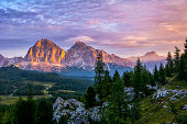 istock Panoramic view of famous Dolomites mountain peaks glowing in beautiful golden evening light at sunset in summer, South Tyrol, Italy. Artistic picture. Beauty of mountains world 1208654624