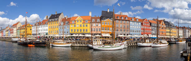Panoramic view of famous Nyhavn district in Copenhagen, Denmark stock photo