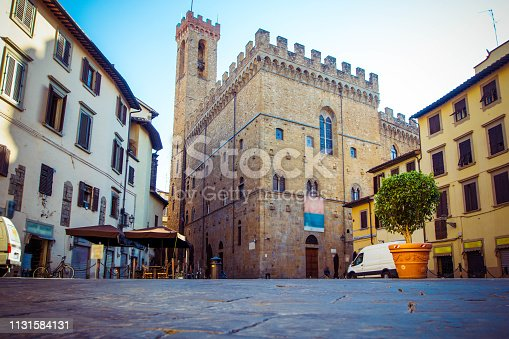 Panoramic view of famous Palazzo Vecchio, old houses and cobbled streets in Florence, Tuscany, Italy