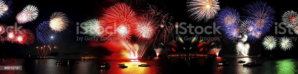 A panoramic view of fireworks over the sea royalty-free stock photo