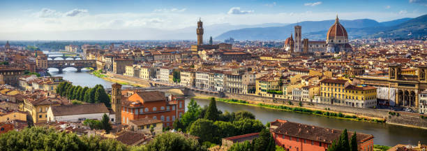 panoramic view of Florence Skyline at Sunset. Italy high resolution and Long exposure panoramic view of Florence Skyline at Sunset with ponte vecchio and Santa Maria del Fiore Duomo. Italy florence italy stock pictures, royalty-free photos & images