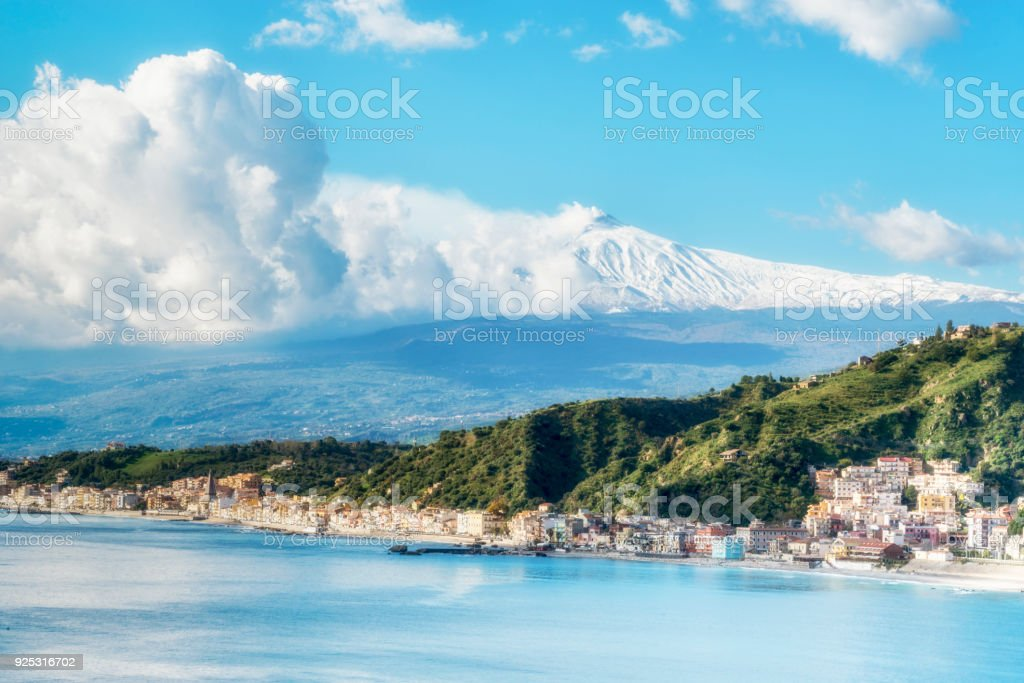 Panoramic view of Giardini Naxos with the Mount Etna. View from Taormina. Province of Messina. Sicily, Italy. stock photo