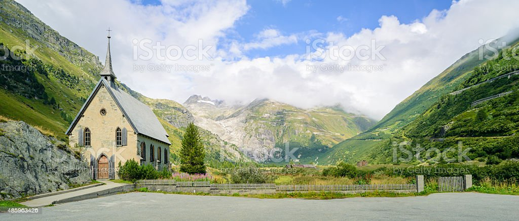 Panoramic View of Gletsch Anglican Chapel and Rhone Glacier Valley stock photo