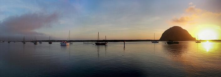 Beautiful Morro Bay harbor along the California coast with destinctive Morro Rock in silhouette.