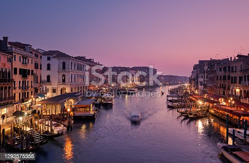istock Venice, Italy - February 18, 2020: Panoramic view of Grand canal from Rialto Bridge during sunset.(Ponte di Rialto) is one of the main tourist attractions of Venice. 1292575355