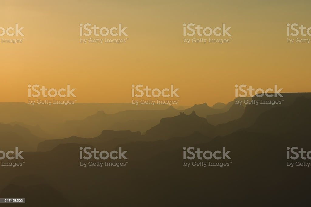 Panoramic View of Grand Canyon in amber colors after sunset stock photo
