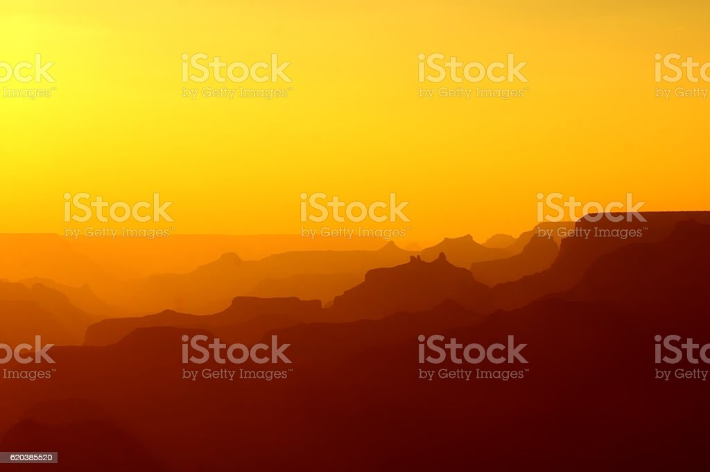 Panoramic View of Grand Canyon in yellow red after sunset stock photo