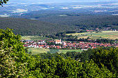 panoramic view of green valley with small village in bavaria