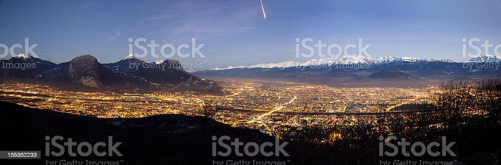 Panoramic view of Grenoble at night stock photo