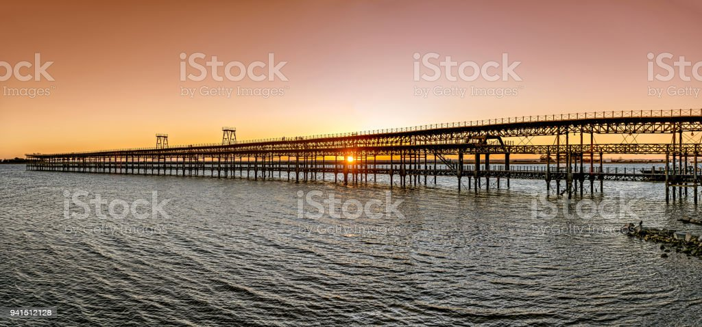 Panoramic view of historic Riotinto pier in Huelva, Spain, at sunset. stock photo