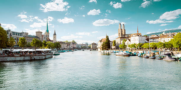 Panoramic view of historic Zurich city center with famous Fraumu Panoramic view of historic Zurich city center with famous Fraumunster and Grossmunster Churches and river Limmat, Switzerland fraumunster stock pictures, royalty-free photos & images