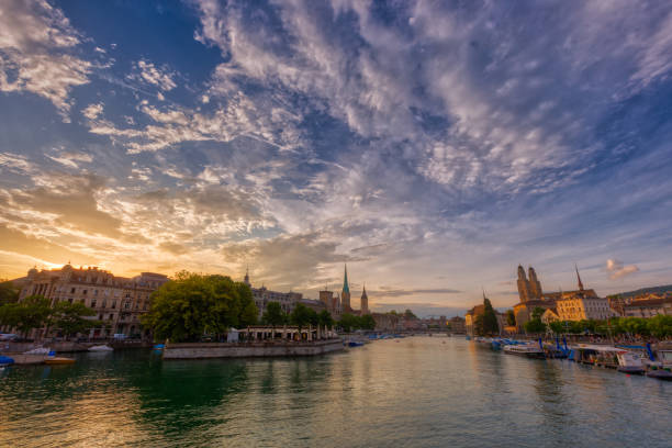 Panoramic view of historic Zurich downtown with Fraumunster and Grossmunster churches at lake zurich during sunset, Switzerland. stock photo