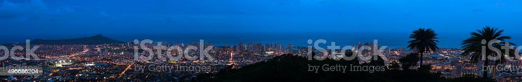 Panoramic view of Honolulu, HI at night stock photo