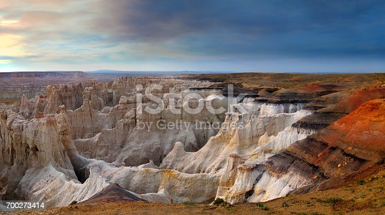 Smoky sky panorama of Coalmine Canyon.  White hoodoos surrounded by red sand.  Spectacular.