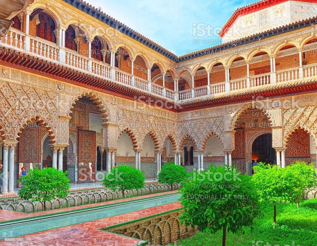 Panoramic view of inner patio- Maidens Courtyard ( Patio De Las Doncellas) of the Royal Alcazar in Seville. stock photo