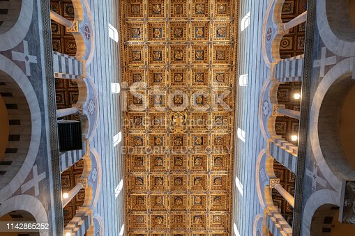 Pisa, Italy - June 29, 2018: Panoramic view of interior of Pisa Cathedral (Cattedrale Metropolitana Primaziale di Santa Maria Assunta) is a medieval Roman Catholic cathedral