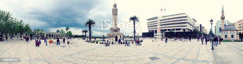 Izmir, Turkey - April 08, 2013 : A group of people are visiting the clock tower in Izmir.Konak Square clock tower taken with iphone in Izmir.Azmir Clock Tower (Turkish: Azmir Saat Kulesi) is a historic clock tower located at the Konak Square in Konak district of Azmir, Turkey. The clock tower was designed by the Levantine French architect Raymond Charles PAre and built in 1901 to commemorate the 25th anniversary of AbdAlhamid II's (reigned 1876aa1909) accession to the throne.