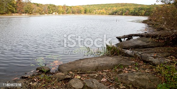 Rocky shoreline along Mountain Lake. Mountain, New Jersey, USA, Mountain Range, Autumn, Autumn Leaf Color,