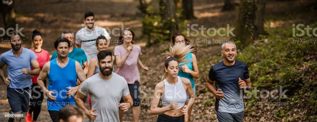 Panoramic view of large group of marathon runners taking part in cross country race. stock photo