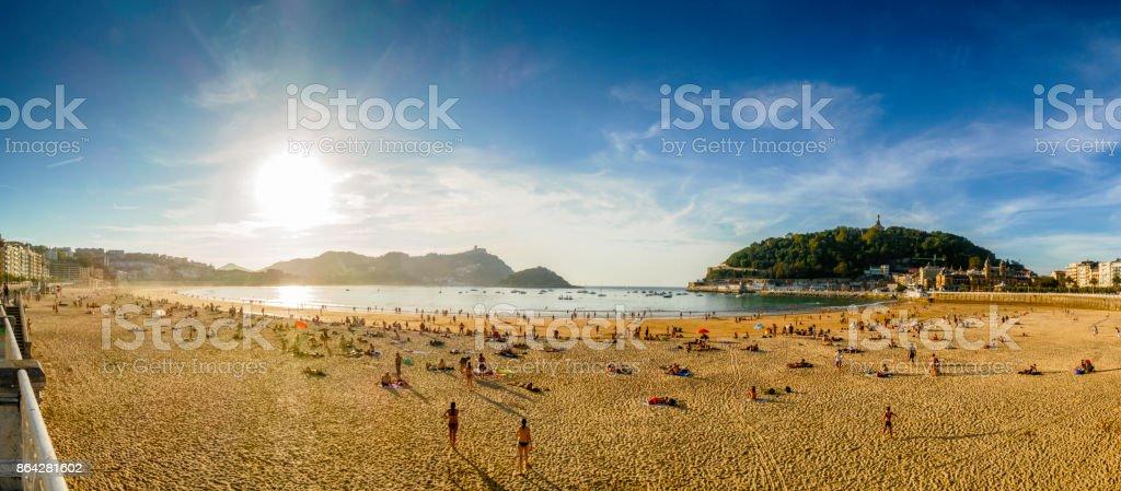 Panoramic view of large group of people enjoying at Playa de La Concha, San Sebastian, Donostia, Basque Country, Spain stock photo
