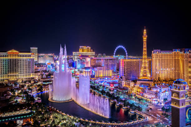 panoramic view of las vegas strip at night in nevada - las vegas stock pictures, royalty-free photos & images