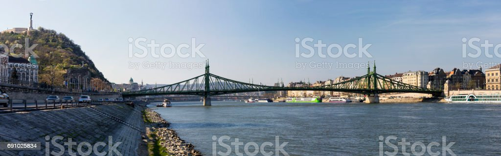 Panoramic view of Liberty Bridge and Gellert Hill with Liberty Statue in Budapest stock photo
