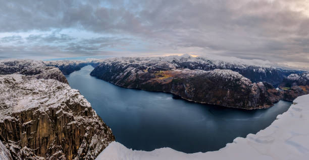 Panoramic view of Lysefjord from the Preikestolen Pulpit Rock, beautiful colors at sunset, Ryfylke, Rogaland, Norway stock photo