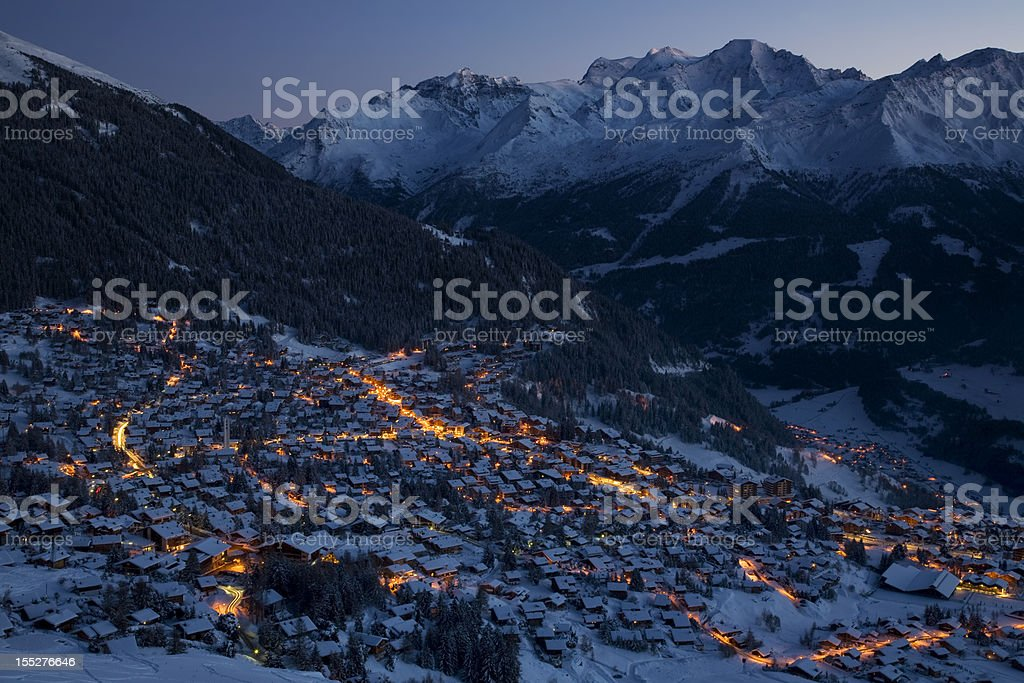 Panoramic view of M. Gele and Verbier Village by night stock photo