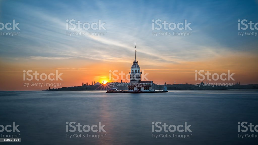 Panoramic view of Maiden's tower from shore during sunset stock photo
