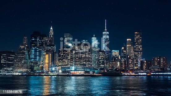istock Panoramic view of Manhattan skyscrapers at night, at Christmas, from the Dumbo area in Brooklyn 1153849876