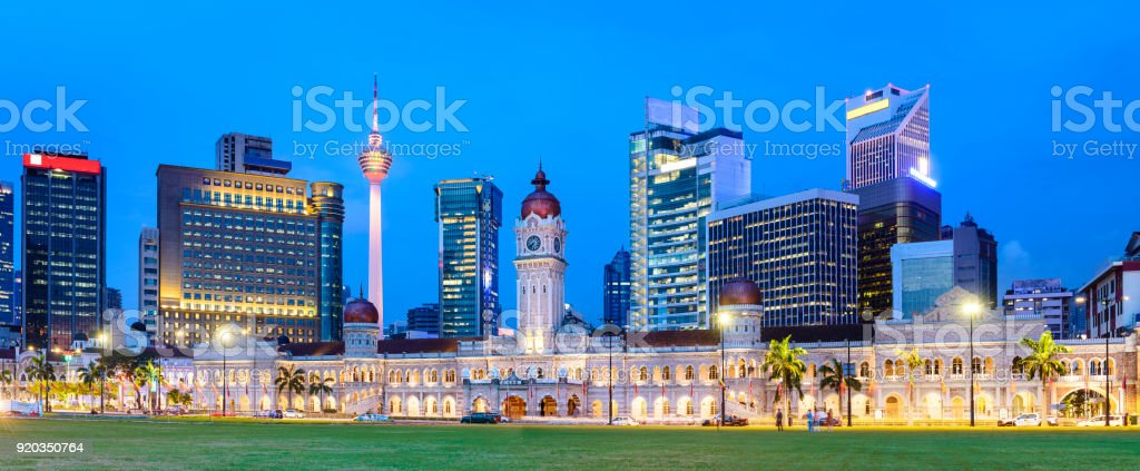 Panoramic View of Merdeka Square and the Kuala Lumpur City Skyline Illuminated at Sunset, Malaysia stock photo