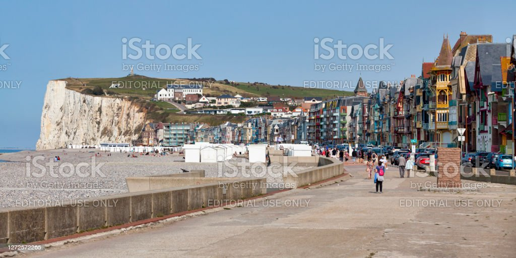 Panoramic view of Mers-les-Bains Mers-les-Bains, France - September 11 2020: Panoramic view of the rows of colorful half-timbered townhouses on the Esplanade du Général Leclerc along the beach. Architecture Stock Photo