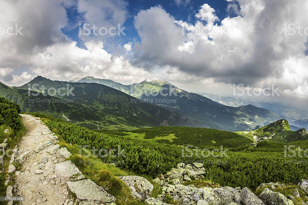 Panoramic view of mountain peaks from the trail royalty-free stock photo